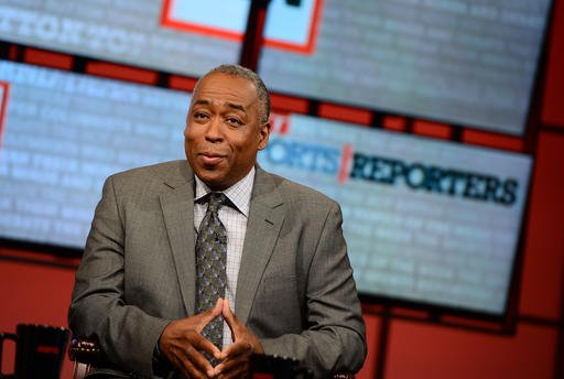 """In this May 12, 2013 photo provided by ESPN Images. John Saunders poses on the set of """"The Sports Reporters"""" in Studio A in Bristol, Conn. (Joe Faraoni/ESPN Images via AP)"""