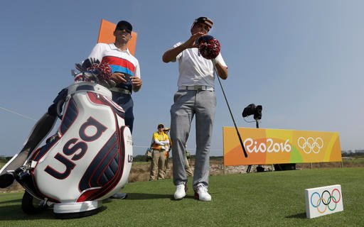Rickie Fowler, of the United States, takes the head cover off his driver at the ninth tee during a practice round for the men's golf event at the 2016 Summer Olympics in Rio de Janeiro, Brazil, Tuesday, Aug. 9, 2016.