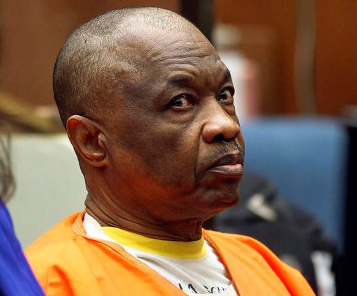 """In this Feb. 6, 2015, file photo, Lonnie Franklin Jr., who has been dubbed the """"Grim Sleeper"""" serial killer, sits during a court hearing in Los Angeles."""