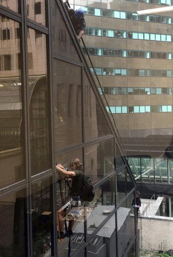 A man scales the all-glass face of Trump Tower in New York, Wednesday, Aug. 10, 2016. The 58-story building is headquarters to the Republican presidential nominee's campaign. He also lives there. (Alex Cannon via AP)