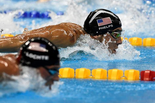 United States' Ryan Lochte and United States' Michael Phelps, right, compete during a men's 200-meter individual medley semifinal.