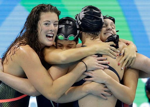 United States' Katie Ledecky, second from right, celebrates with her teammates Allison Schmitt, Maya DiRado and Leah Smith.
