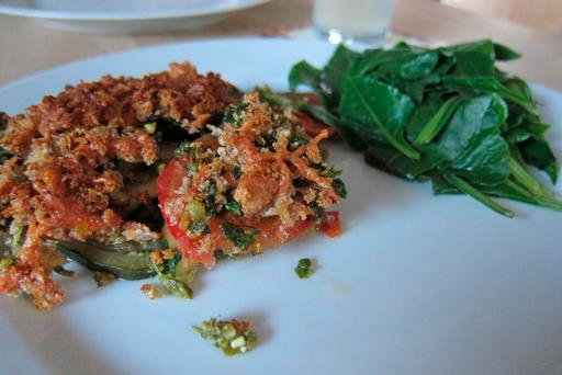 This July 12, 2016 photo shows a baked pesto dish made from a plant called fat hen, with a serving of the leaves on the side, as part of a dinner made from wild plants gathered in the county of Dorset in southwest England. (AP Photo/Jerry Harmer)
