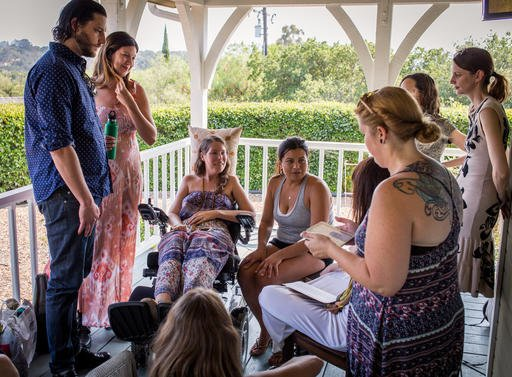 This July 24, 2016 photo provided by Niels Alpert, Betsy Davis, third from left, has a laugh with her friends during a going away party in Ojai, Calif. In early July, Davis emailed her closest friends and family to invite them to a two-day celebration, te