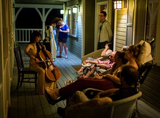 This July 23, 2016 photo provided by Niels Alpert, Kestrin Pantera plays her chello at a going away party for her friend Betsy Davis in Ojai, Calif. In early July, Davis emailed her closest friends and family to invite them to a two-day celebration, telli