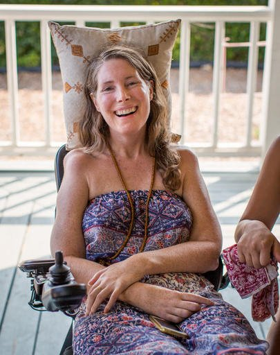 This July 24, 2016 photo provided by Niels Alpert, Betsy Davis, smiles during a going away party with her family and friends in Ojai, Calif. In early July, Davis emailed her closest friends and family to invite them to a two-day celebration, telling them: