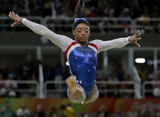 United States' Simone Biles performs on the balance beam during the artistic gymnastics women's individual all-around final at the 2016 Summer Olympics in Rio de Janeiro, Brazil, Thursday, Aug. 11, 2016.