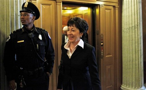 Sen. Susan Collins, R-Maine, steps off an elevator as she arrives for a vote on Capitol Hill in Washington, Wednesday, Oct. 14, 2009. Collins, signaled Wednesday she's open to voting for sweeping health care legislation this year.(AP Photo/Charles Dharap)
