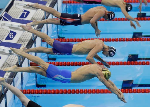 Brazil's Thiago Pereira, United States' Michael Phelps, center, and United States' Ryan Lochte, top, compete in the final of the men's 200-meter.