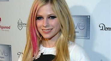 FILE - In this Monday, Dec. 31, 2007 file photo, musician Avril Lavigne walks the red carpet before a New Years Eve Party at Prive in the Planet Hollywood Resort and Casino in Las Vegas Court records show Avril Lavigne has filed for divorce from her music