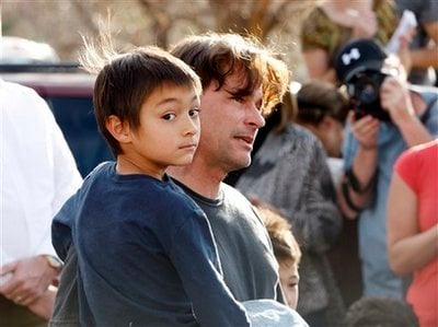 Six-year-old Falcon Heene is shown with his father, Richard, outside the family's home in Fort Collins, Colo., after Falcon Heene was found hiding in a box in a space above the garage on Thursday, Oct. 15, 2009. Falcon Heene at first had been reported to