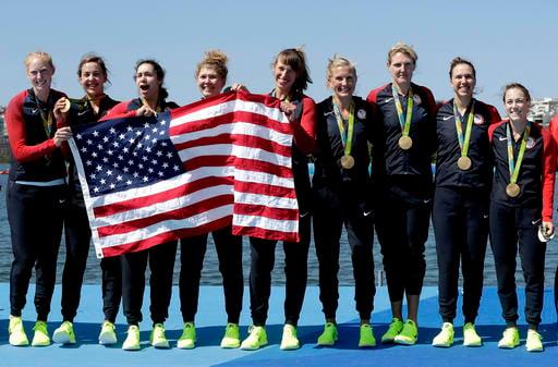 Emily Regan, Kerry Simmonds, Amanda Polk, Lauren Schmetterling, Tessa Gobbo, Meghan Musnicki, Eleanor Logan, Amanda Elmore and Katelin Snyder, of United States, celebrate winning gold.