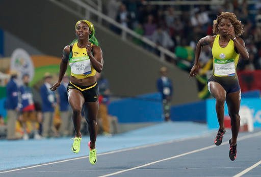 Jamaica's Shelly-Ann Fraser-Pryce, left, and Ecuador's Narcisa Landazuri compete in a women's 100-meter heat.