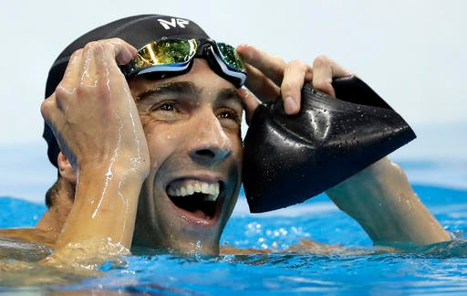 United States' Michael Phelps reacts after the men's 100-meter butterfly final during the swimming competitions.
