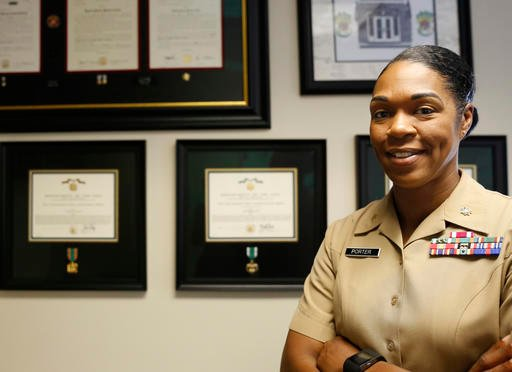 Maj. Shanelle Porter, commanding officer at the Recruiting Station Chicago poses in her office in Des Plaines, Ill.