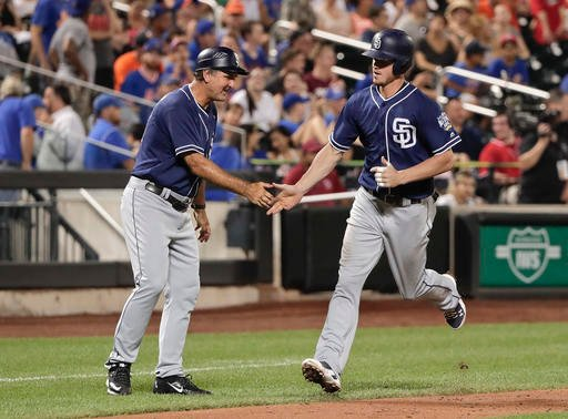 San Diego Padres Wil Myers, right, is congratulated by third base coach Glenn Hoffman after hitting a solo home run against the New York Mets during the ninth inning of a baseball game, Saturday, Aug. 13, 2016, in New York. (AP Photo/Julie Jacobson)