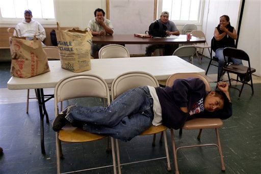 Unemployed worker Jesus Hernandez, who has been unemployed for over a month, waits with other unemployed people at the Day Worker Center of Mountain View, in Mountain View, Calif., Friday, Oct. 2, 2009. (AP Photo/Paul Sakuma)