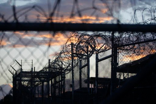 In this Nov. 21, 2013 file photo reviewed by the U.S. military, dawn arrives at the now closed Camp X-Ray, which was used as the first detention facility for al-Qaida and Taliban militants who were captured after the Sept. 11 attacks, at the Guantanamo Ba