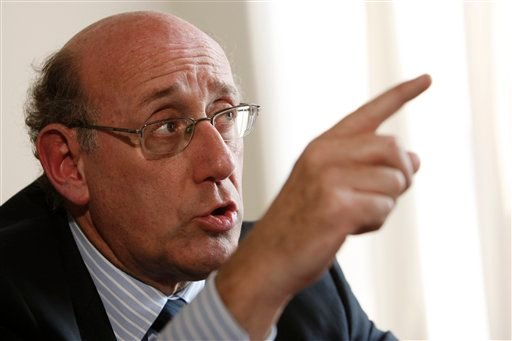 FILE - In this Aug. 15, 2007 file photo, Kenneth R. Feinberg, now the special master at the Treasury Department appointed by President Obama to handle compensation issues, speaks at his office in Washington. (AP Photo/Charles Dharapak, File)