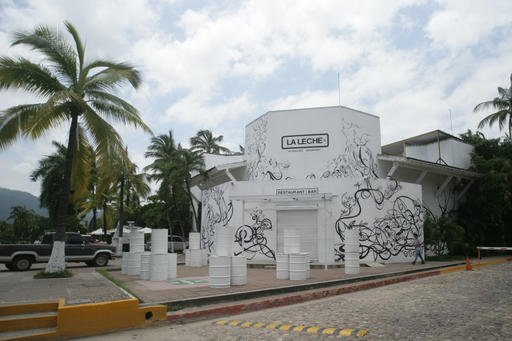 "The entrance of the restaurant ""La Leche"" stands closed after armed men abducted as many as 16 people who were dining in the upscale restaurant in Puerto Vallarta, Mexico, Monday, Aug. 15, 2016. Jalisco state prosecutor Eduardo Almaguer said in a news con"