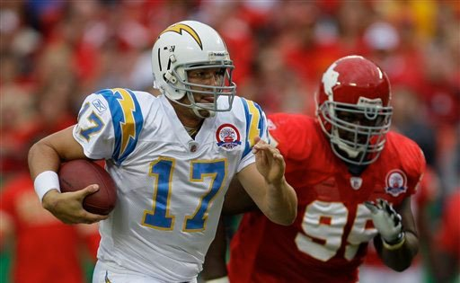 San Diego Chargers quarterback Philip Rivers (17) runs for 11 yards ahead of Kansas City Chiefs defensive tackle Ron Edwards (95) during the first half of an NFL football game Sunday, Oct. 25, 2009, in Kansas City, Mo. (AP Photo/Olin Wagner)