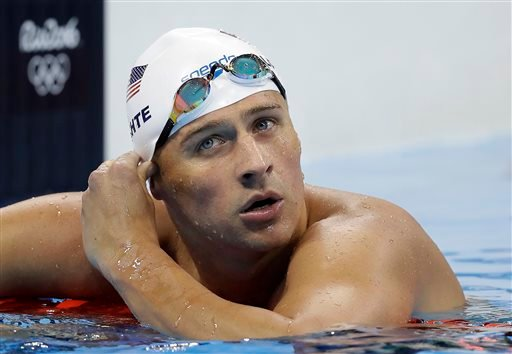 United States' Ryan Lochte checks his time in a men's 4x200-meter freestyle heat during the swimming competitions.