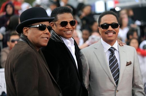 """Randy Jackson, left, Tito Jackson and Marlon Jackson, right, arrive to the premiere of """"Michael Jackson's This Is It"""" on Tuesday, Oct. 27, 2009, in Los Angeles. (AP Photo/Matt Sayles)"""