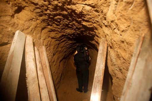 A cameraman takes footage inside a tunnel near the US-Mexico border in Tijuana, Mexico, Tuesday, Oct. 27, 2009. Mexican soldiers have discovered a secret tunnel complete with electricity and an air supply. (AP Photo/Guillermo Arias)