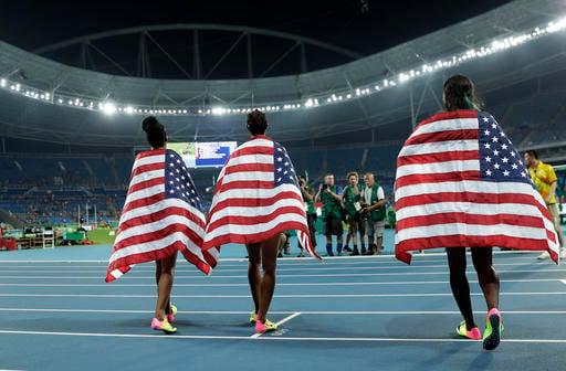 Gold medal winner Brianna Rollins, center, silver medal winner, Nia Ali, right , and bronze medal winner Kristi Castlin, all from the United States.