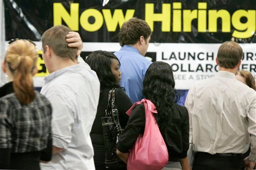 Job seekers line up in front of a Dollar General booth at a Little Rock, Ark., job fair. New jobless claims drop less than expected to 530,000 Thursday, Oct. 29, as labor market remains weak.(AP Photo/Danny Johnston)