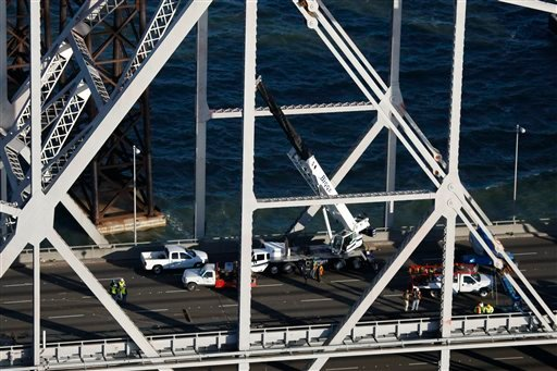 Crews work on the Bay Bridge in San Francisco, Wednesday, Oct. 28, 2009. The San Francisco-Oakland Bay Bridge has been closed indefinitely after a rod installed during last month's emergency repairs snapped. (AP Photo/Marcio Jose Sanchez)