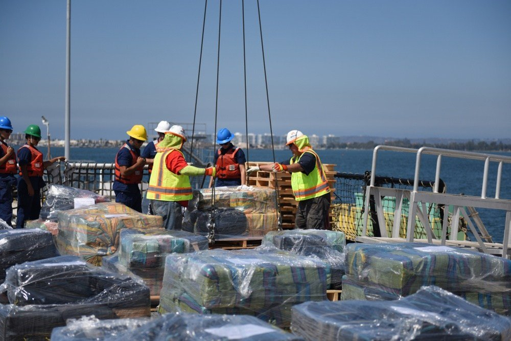 The crew of the Coast Guard Cutter Sherman offloads pallets of cocaine at Naval Base San Diego on August 18, 2016. Approximately 11 tons of cocaine was seized during 15 separate interdictions in the Eastern Pacific. (U.S. Coast Guard photo by Petty Office
