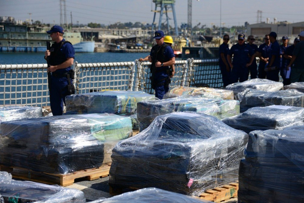 The crew of the Coast Guard Cutter Sherman prepares to offload 11 tons of cocaine at Naval Base San Diego on August 18, 2016. The contraband was seized by five cutters during 15 separate interdictions in the Eastern Pacific. (U.S. Coast Guard photo by Fir