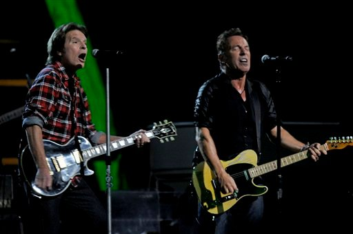 Bruce Springsteen, right, and John Fogerty perform at the 25th Anniversary Rock & Roll Hall of Fame concert at Madison Square Garden,Thursday, Oct. 29, 2009 in New York. (AP Photo/Henny Ray Abrams)