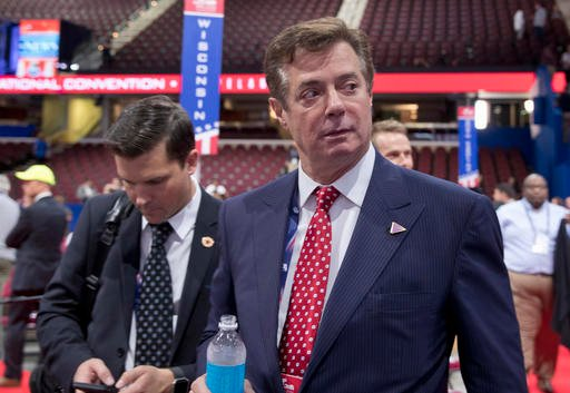Trump campaign chairman Paul Manafort walks around the convention floor.