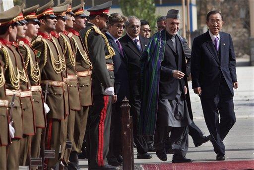 Afghan President Hamid Karzai, second right, inspects with U.N. Secretary-General Ban Ki-moon, right, an honor guard in Kabul, Afghanistan, Monday, Nov. 2, 2009. (AP Photo/Ahmad Masood, Pool)