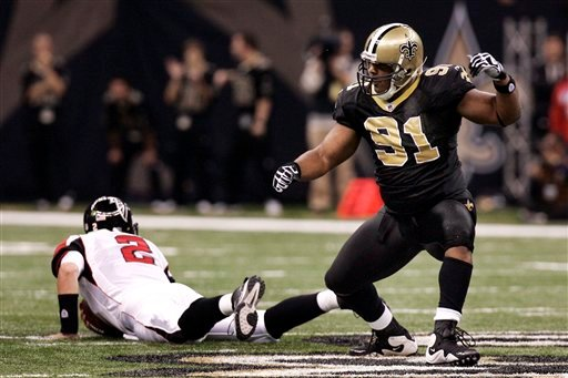 New Orleans Saints defensive end Will Smith (91) celebrates after sacking Atlanta Falcons quarterback Matt Ryan (2) in the first half of an NFL football game in New Orleans, Monday, Nov. 2, 2009. (AP Photo/Patrick Semansky)