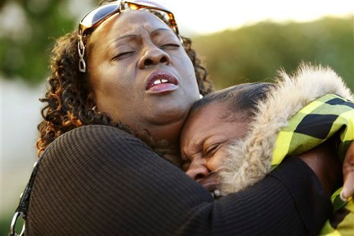 Monquasha Peter, right, 19, cousin of rape suspect Marcelles Peter, 17, is hugged by family friend Deborah Hamilton-Turnipseed, as they claim his innocence outside of a Richmond, Calif., courthouse, Thursday, Oct. 29, 2009.  (AP Photo/Paul Sakuma)