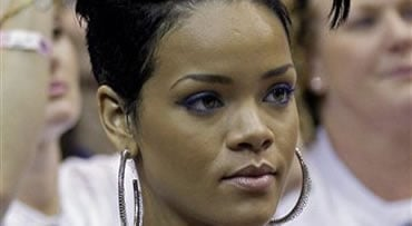 FILE - In this June 11, 2009 file photo, singer Rihanna watches the second quarter of Game 4 of the NBA basketball finals between the Los Angeles Lakers and Orlando Magic in Orlando, Fla. (AP Photo/David J. Phillip, file)