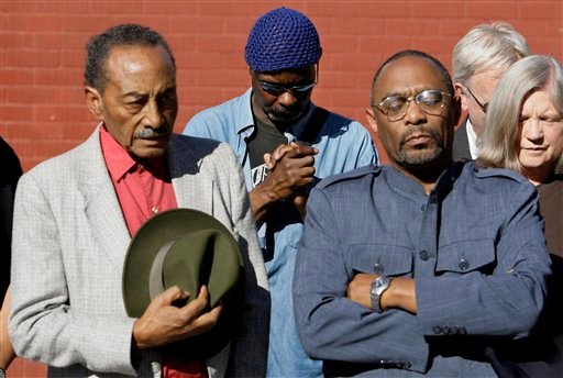 From left, Bill Williams, Dexter Young, and Bishop Andre Jackson bow their head in prayer at a rally at Richmond High School in Richmond, Calif., Monday, Nov. 2, 2009. (AP Photo/Jeff Chiu)