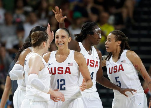 United States' Diana Taurasi (12) celebrates with teammates during a women's gold medal basketball game.