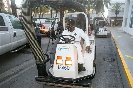 A City of Miami Beach Sanitation worker gets ready to clean the alleyways of South Beach.