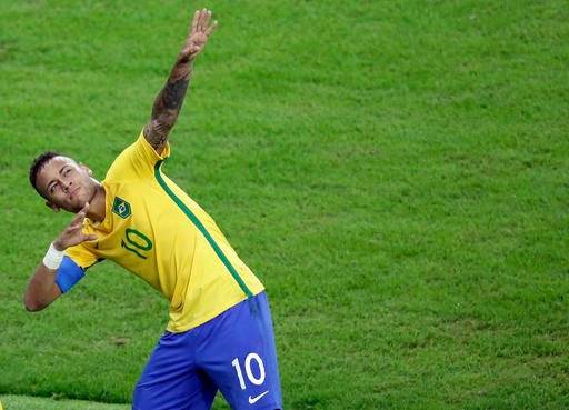 Brazil's Neymar celebrates after scoring his team's first goal on a free kick during the final match.
