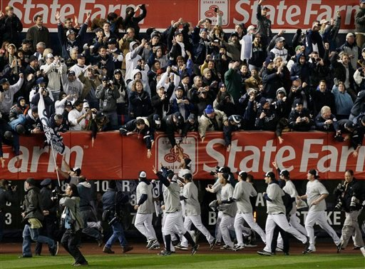 New York Yankees celebrate with fans after winning the Major League Baseball World Series against the Philadelphia Phillies Wednesday, Nov. 4, 2009, in New York.(AP Photo/Julie Jacobson)