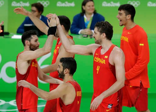 Spain's Pau Gasol (4) celebrates with teammates after the bronze medal basketball game against Australia at the 2016 Summer Olympics in Rio de Janeiro, Brazil, Sunday, Aug. 21, 2016. (AP Photo/Charlie Neibergall)