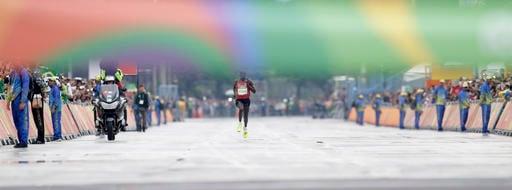 Kenya's Eliud Kipchoge rushes to finish line to win the men's marathon at the 2016 Summer Olympics in Rio de Janeiro, Brazil, Sunday, Aug. 21, 2016. (AP Photo/Petr David Josek)