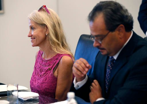 Kellyanne Conway, left, campaign manager for Republican presidential candidate Donald Trump, attends his Hispanic advisory roundtable meeting in New York, Saturday, Aug. 20, 2016. At right is Rick Figueroa, first vice president for FINC Firm of Houston. (