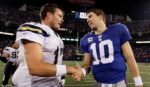 San Diego Chargers quarterback Philip Rivers, left, shakes hands with New York Giants quarterback Eli Manning after an NFL football game, Sunday, Nov. 8, 2009.