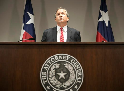 In this May 25, 2016, file photo, Republican Texas Attorney General Ken Paxton announces Texas' lawsuit to challenge President Obama's transgender bathroom order during a news conference in Austin, Texas. A federal judge in Texas is blocking for now the O