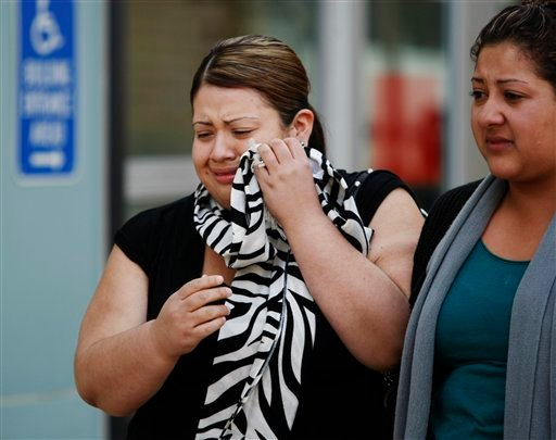 Two women who were identified as related to rape suspect Elvis Josue Torrentes, leave a Richmond, Calif. courthouse on Thursday, Nov. 5, 2009. (AP Photo/Paul Sakuma)